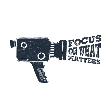 Hand drawn 90s themed badge with camcorder vector illustration and Focus on what matters inspirational lettering. Illustration