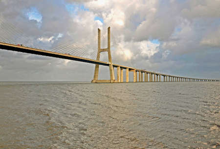 The new highway over the river Tagus in Lisbon, was commissioned in April 1, 1998 g - to 500-th anniversary of explorer Vasco da Gama sea route from Europe to India. Bridge - one of several large-scale construction projects on the Iberian peninsula, made  photo