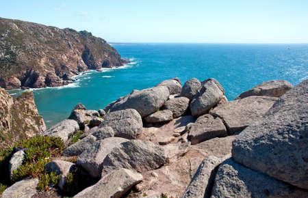 Portugal beach mountain cliff drops splashing water photo