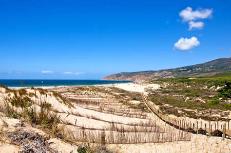 mediteranean: Portugal beach sand ladder clouds nature landscape Stock Photo