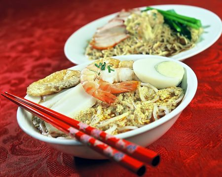 Asian dish of Prawns, Seafood, Tofu, Noodles, and green vegetable