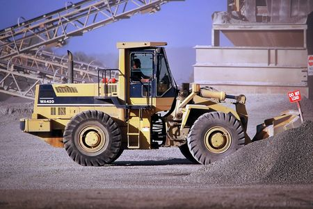 front end: Front End loader working  stockpile in Quarry Stock Photo