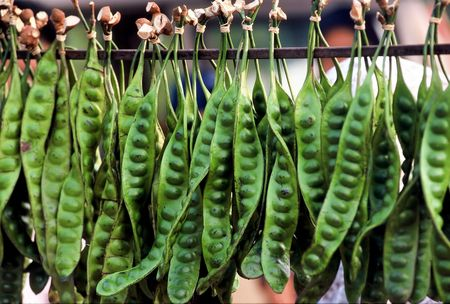 Asian green Vegetable, hanging on display for sale at outdoor market