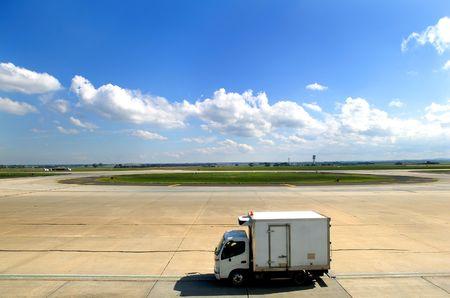 Airport Catering van moving across Tarmac Stock Photo