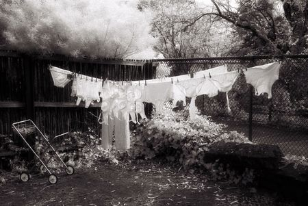 infra red: Black and White Infra Red image of Washing line full of clothes (intentional grain)