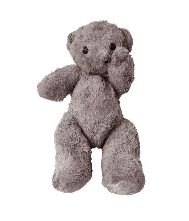 Very old and worn Teddy bear in sad pose because he got left behind by a child after stay in hospital