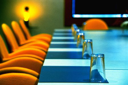 Interior of modern boardroom with yellow chairs and funky retro d�cor, photographed on color infra red film(grainy) photo