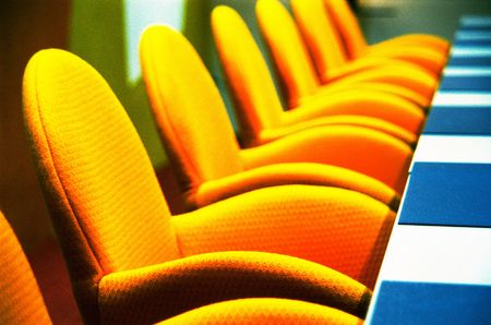 Interior of modern boardroom with yellow chairs and funky retro d�cor, photographed on color infra red film(grainy)