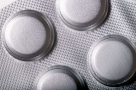 Tablets in silver foil packaging