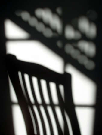 gloom: Abstract shadow patterns from chair and window Stock Photo