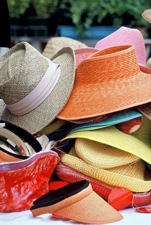 Pile of assorted second hand Hats on sale at an outdoor market