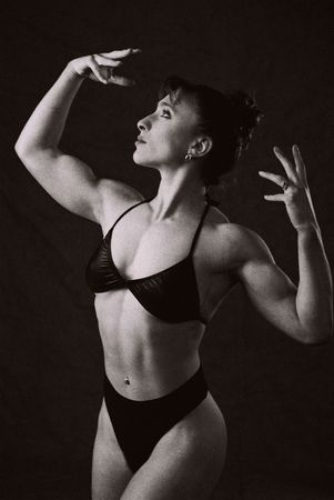intentional: Female Bodybuilder in competition pose, photographed on Infra Red Black and White film, intentional grain