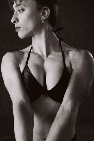 infra red: Female Bodybuilder in competition pose, photographed on Infra Red Black and White film, intentional grainFemale Bodybuilder in competition pose, photographed on Infra Red Black and White film, intentional grain