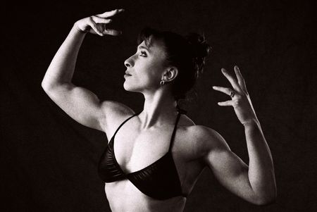 infra red: Female Bodybuilder in competition pose, photographed on Infra Red Black and White film, intentional grain