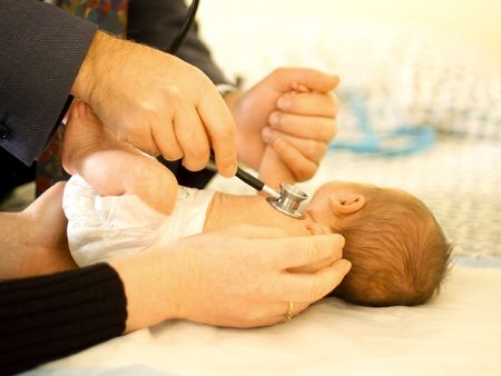 Premature baby boy having medical check up with Paediatrician using stethoscope Stock Photo