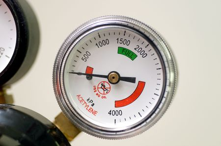Dial of a pressure gauge known as a Bourdon Gauge, used on a gas cylinder