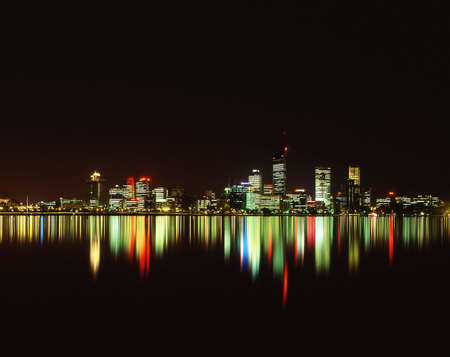 Night time view of city of Perth, reflected in Swan River photo
