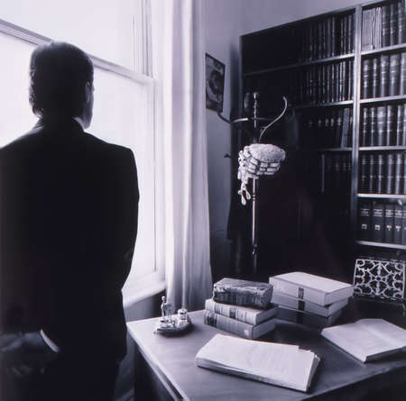 solicitor: A Lawyer stands in his office looking out the window