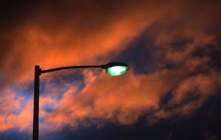 vapour: Lone mercury vapour street lamp with spectacular sunset