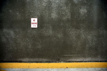 no parking: View of wall in laneway with No Parking sign