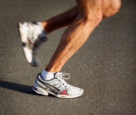 Close up detail view of athletes legs and feet, competing in a Marathon race Stock Photo