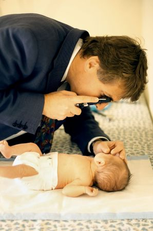 paediatrics: Premature baby boy having a check up and tests with a Paediatrician