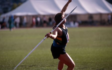 javelin: Male athlete about to release Javelin at Athletics competition