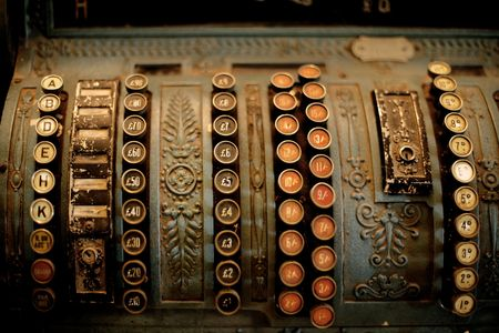 Detail of beautiful old mechanical cash register photo