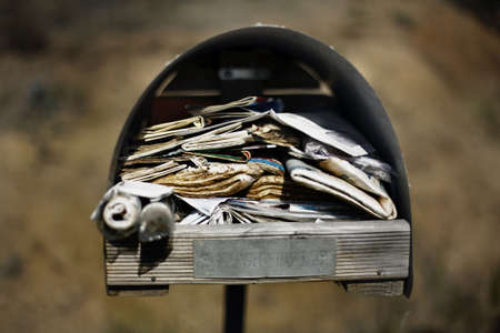 Large roadside letterbox, overflowing with uncollected mail Stock Photo - 3077759