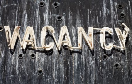 Old Neon Vacancy sign outside closed down motel Stock Photo