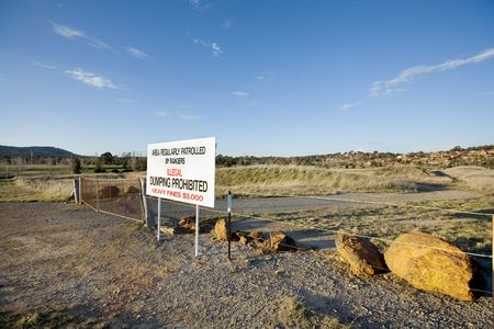 vacant land: A sign on vacant land warning against Illegal dumping