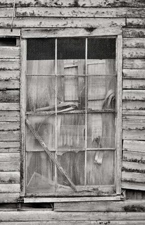 derelict: Old derelict building window in weatherboard warehouse