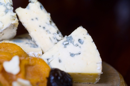 penicillium: A cheese platter featuring blue vein and camembert cheeses Stock Photo