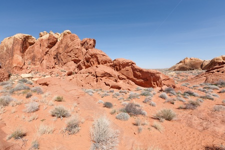 derives: Valley of Fire State Park is the oldest state park in Nevada, USA. It covers an area of 34,880 acres (14,120 ha) and was dedicated in 1935. It derives its name from red sandstone formations. Stock Photo