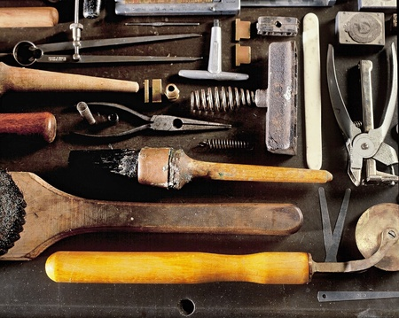 book binding: Still life of an assortment of tools used for hand book binding