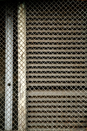 Detail close up of wire mesh screen in front of building window Stock Photo - 16881267