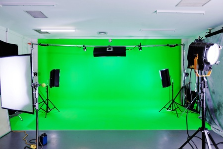 filming: Green Screen video production studio with lights set ready for filming