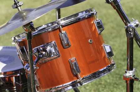 snare: Detail of a drum kit showing Snare Drum and drumsticks