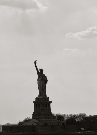 neoclassical: Silhouette of the Statue of Liberty which is a colossal neoclassical sculpture on Liberty Island in the middle of New York Harbor, in Manhattan, New York City.