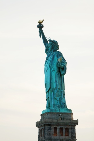 neoclassical: Statue of Liberty which is a colossal neoclassical sculpture on Liberty Island in the middle of New York Harbor, in Manhattan, New York City.