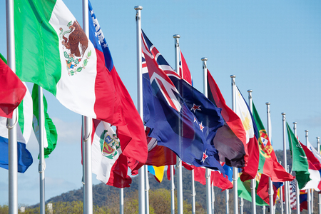 brisk: Australian Flag blowing in a brisk breeze on a flagpole