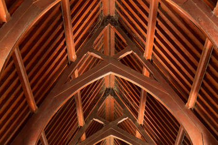 rafters: Abstract view of timber rafter beams of an old church building Stock Photo