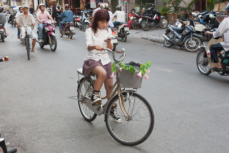 min: Saigon, Vietnam-October 14 The streets of Saigon(Ho Chi Min City) are crowded with scooters, motorbikes and bicycles, October 14, 2009. Populated by more than 9,million people, it is the most populous metropolitan area in Vietnam