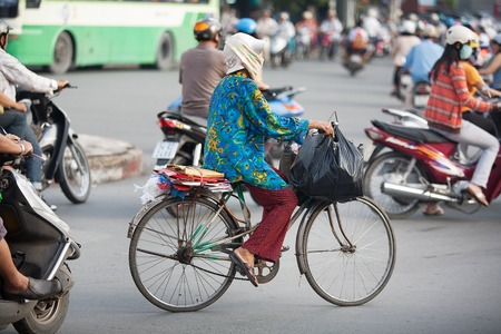 min: Saigon, Vietnam-October 16. The streets of SaigonHo Chi Min City are crowded with scooters, motorbikes and bicycles, October 16, 2009. With more than 9 million people, it is the most populous city area in Vietnam Editorial