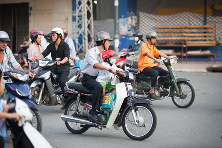 min: Saigon, Vietnam-October 16. The streets of Saigon(Ho Chi Min City) are crowded with scooters, motorbikes and bicycles, October 16, 2009. With more than 9 million people, it is the most populous city area in Vietnam