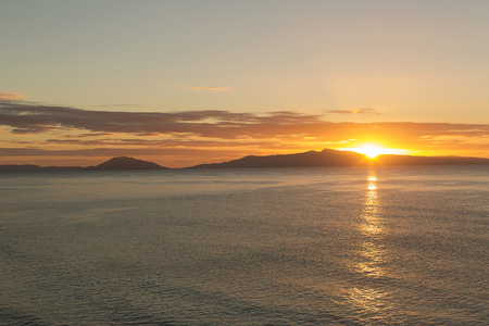 scenic landscapes: View out across the ocean of sunrise on the East Coast of Tasmania, Australia