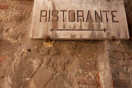 township: Views of direction sign for a restaurant in  the old township of Perugia in the Umbrian region of Italy