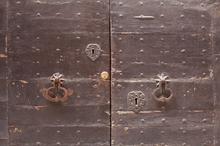 township: Detail of timber door with keyhole and knockerin  the old township of Perugia in the Umbrian region of Italy