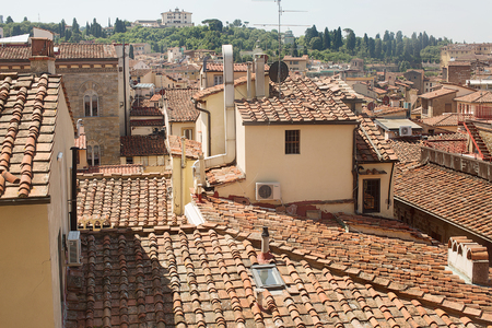 rooftops: View over the terracotta tiled rooftops of Florence
