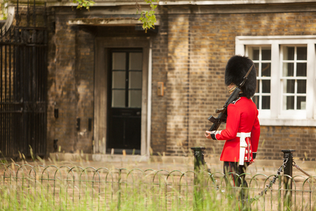 guard house: London, United Kingdom-May 20, 2013. Queens Guard on duty at the entrance to Clarence House, London, England